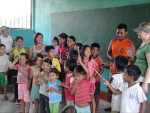 Children of the Ticuna tribe receiving school material from Colombia Remote Adventures